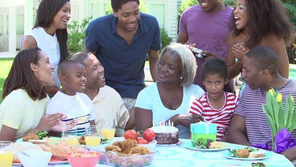 Multi generation family celebrating birthday in garden Royalty-free stock video