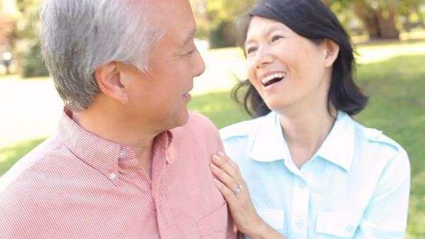 Senior asian couple walking through park together Royalty-free stock video