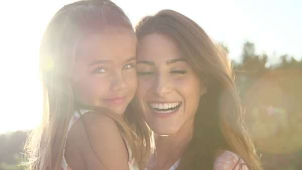 Portrait of hispanic mother and daughter in slow motion Royalty-free stock video