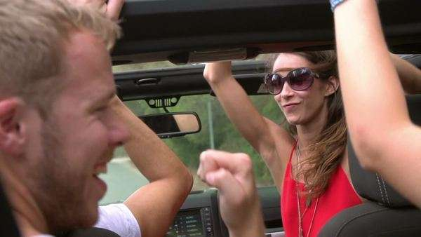 Slow motion shot of friends dancing in back of open top car Royalty-free stock video