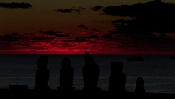 Timelapse shot of sun setting behind Moai silhouettes Rights-managed stock video