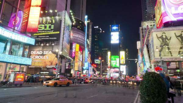 Panning shot of busy Times Square at night Rights-managed stock video