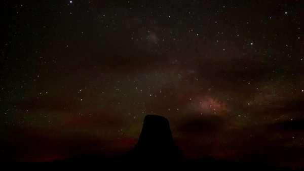 Static shot and timelapse video showing the outline of a cliff against a sky full of stars Rights-managed stock video