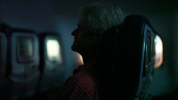 Handheld shot of passengers in an airplane during landing Royalty-free stock video