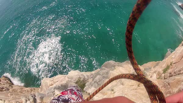 POV young man jumps from cliff into sea Royalty-free stock video