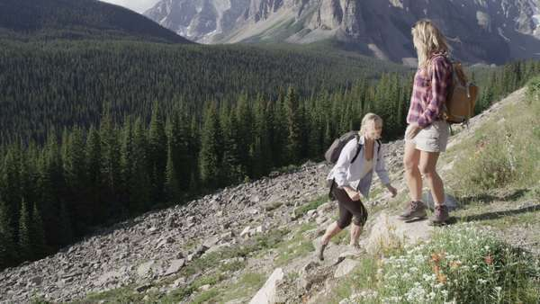 Slow motion of women hiking up a mountain Royalty-free stock video