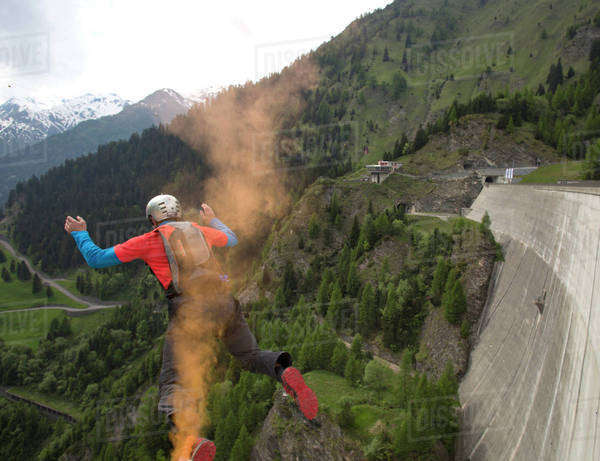Man base jumping at the Contra dam in Ticino canton, Switzerland Royalty-free stock photo