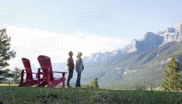 Couple admiring the view in the mountains Royalty-free stock photo