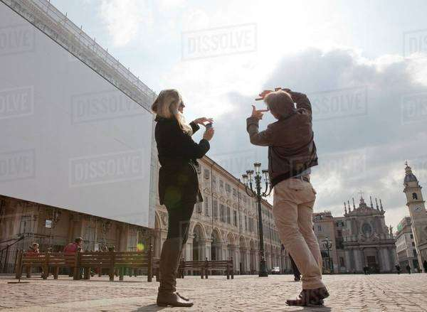 Couple taking pictures of Piazza San Carlo, Turin, Italy Royalty-free stock photo