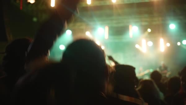 People dancing at open air rock festival during night Royalty-free stock video