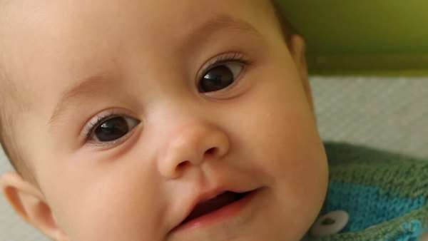 Extreme close-up of cute happy baby girl Royalty-free stock video