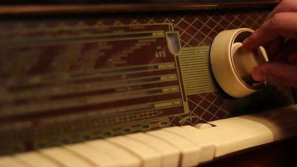 Searching for favorite radio station, on a vintage wooden case radio Royalty-free stock video
