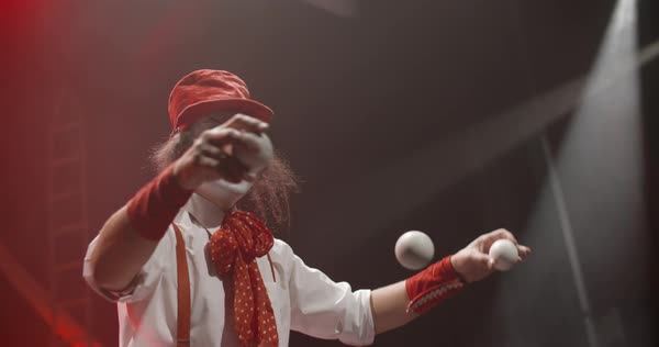 Close-up shot of two jugglers playing with juggling balls during stage performance Royalty-free stock video