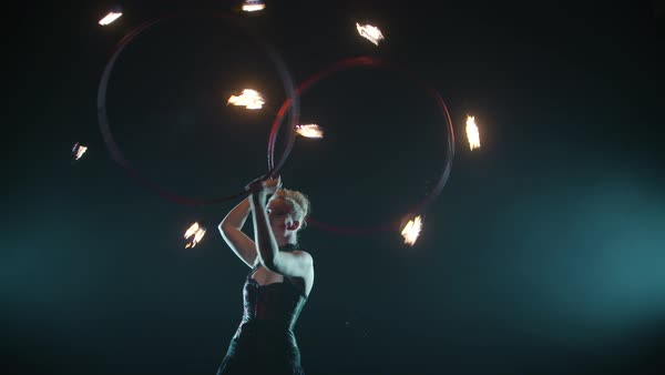 A female performer spinning fire hula hoop during her stage performance Royalty-free stock video