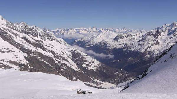 Snow covered Swiss Alps on a sunny day during winter Royalty-free stock video