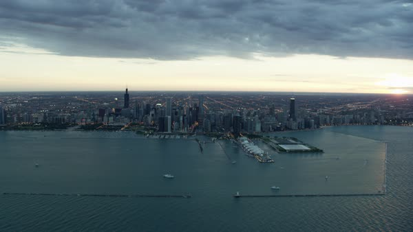 Aerial distant view at sunset of Chicago USA cityscape and Lake Michigan Royalty-free stock video