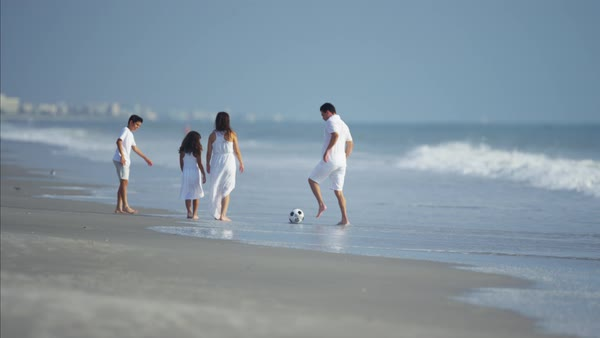 Happy family having fun with ball on beach vacation Royalty-free stock video