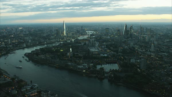 Aerial distant sunset view of the River Thames and city skyline of London UK Royalty-free stock video