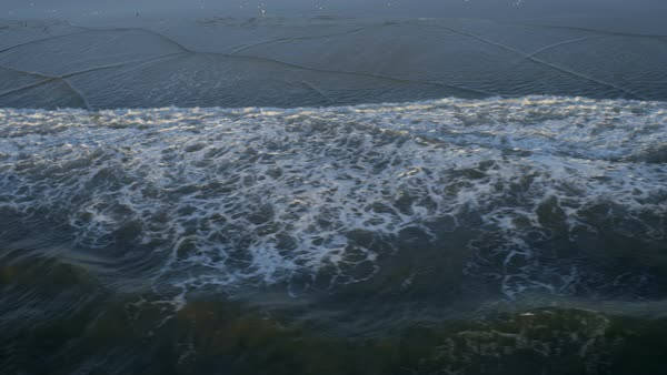 Aerial view of Pacific ocean waves washing on shore coastal seabirds near ocean surface Los Angeles California USA Royalty-free stock video