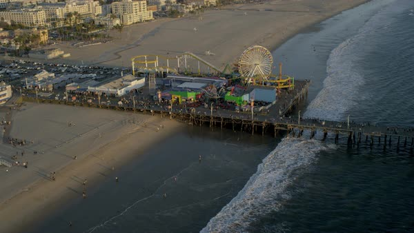 Aerial view of the Pacific ocean Santa Monica Pier amusements and Ferris wheel Los Angeles California USA Royalty-free stock video