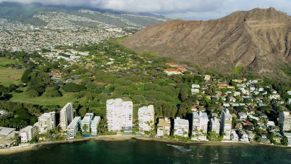 Aerial view of Waikiki a tropical resort near the volcanic slopes of Diamond Head Oahu Hawaii USA Royalty-free stock video