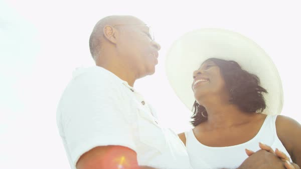 Affectionate senior African American couple laughing and dancing on the beach Royalty-free stock video