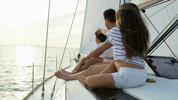 Happy Hispanic family in casual clothing at leisure sailing the ocean on luxury yacht on relaxing getaway Royalty-free stock video
