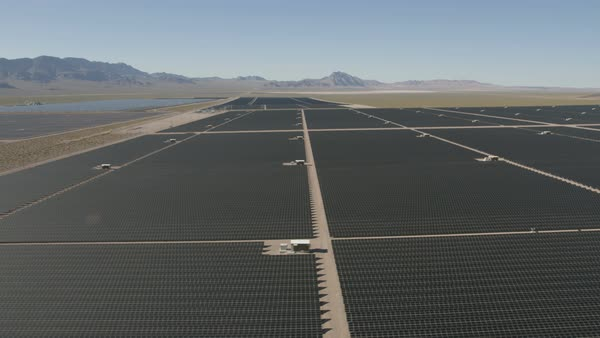 Aerial view Nevada Solar One Photovoltaic Solar units being used to produce natural clean energy for business industrial production Nevada USA Royalty-free stock video