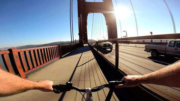 POV Cycle rider Golden Gate Bridge traffic San Francisco USA Royalty-free stock video