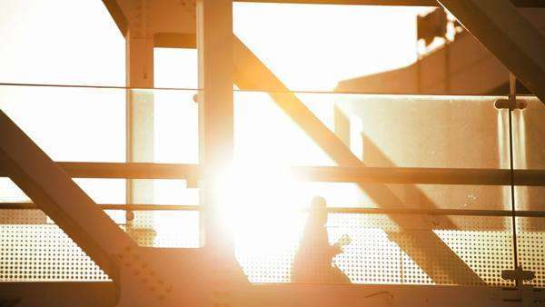 Walkway people elevated gantry Tokyo sun flare Metropolis Tokyo Japan Royalty-free stock video