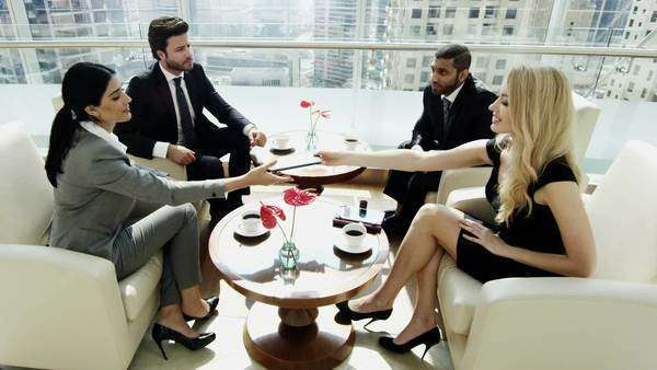 Group of four colleagues in a business meeting Royalty-free stock video