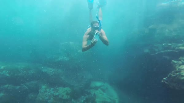 Hand-held shot of a diver taking pictures underwater Royalty-free stock video