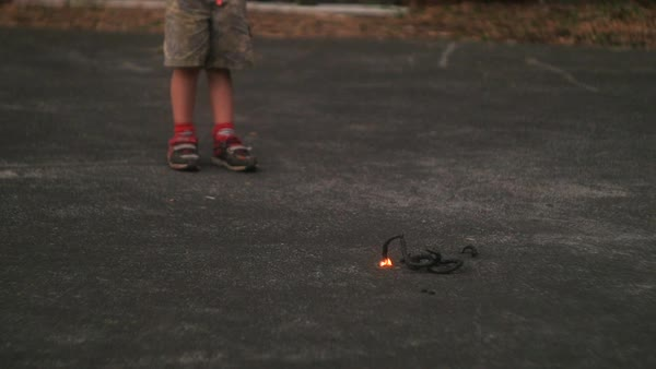 Hand-held shot of a child standing next to a burning coil Royalty-free stock video