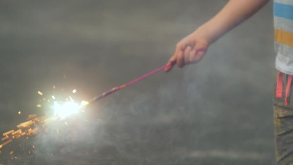 Mid-section shot of a boy holding a hand-held firework Royalty-free stock video