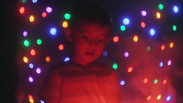 Slow motion of a boy staring at fire Royalty-free stock video