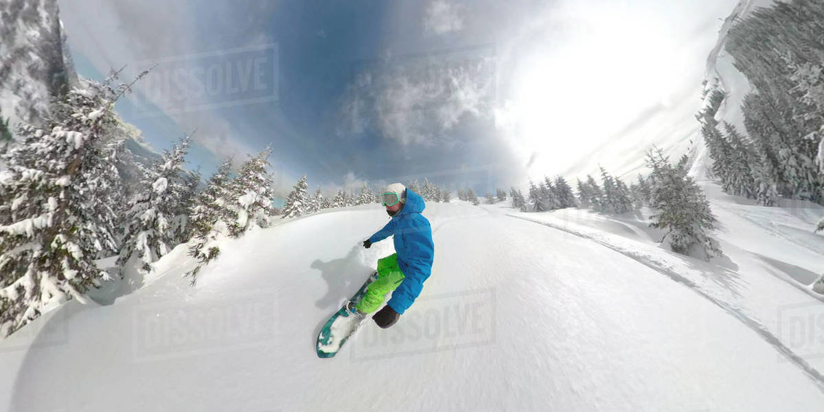 360 Overcapture 3d Extreme Male Snowboarding Athlete Carves Through Fresh Snow Snowboarder Descends Down Dangerous Mountain Covered In Fresh Powder Snow Cool Freerider Snowboards In Pristine Nature Stock Photo Dissolve