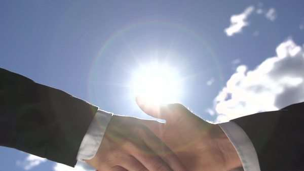 Handshake over the sun Royalty-free stock video