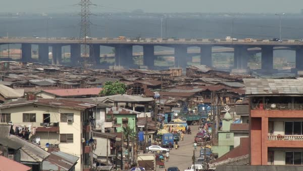 Wide shot of traffic on a bridge in an African city Rights-managed stock video