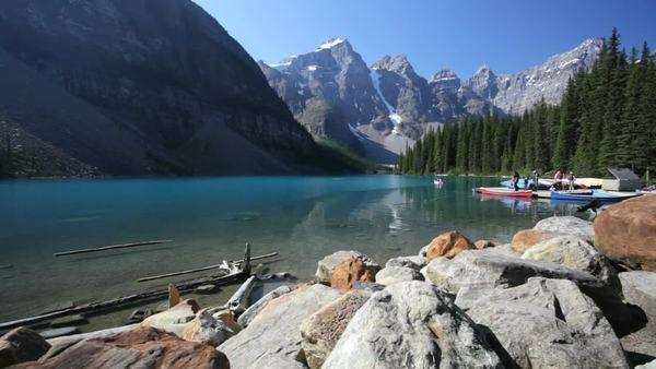 People getting into canoes at Moraine Lake, Banff National Park, Canada Royalty-free stock video