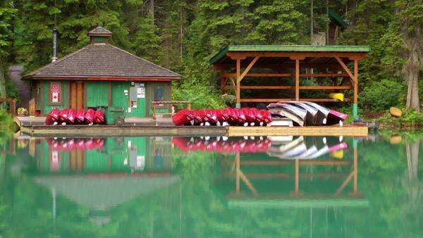 Serene scene of boat house on Emerald Lake in Yoho National Park Royalty-free stock video