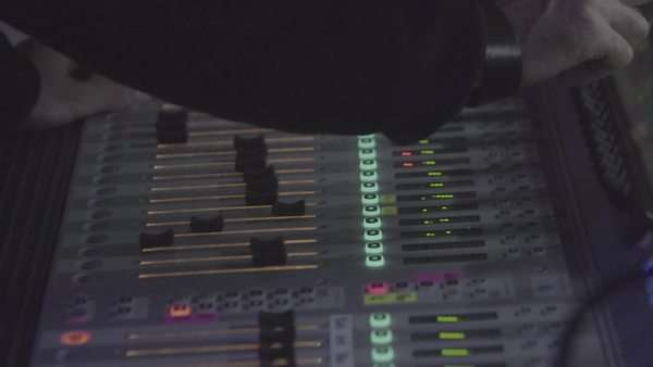Close-up shot of an audio engineer using the mixing console Royalty-free stock video
