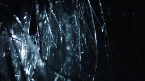 Defocused shot of broken glass pieces stock video footage dissolve macro shot of broken glass pieces against black background royalty free stock video voltagebd Gallery