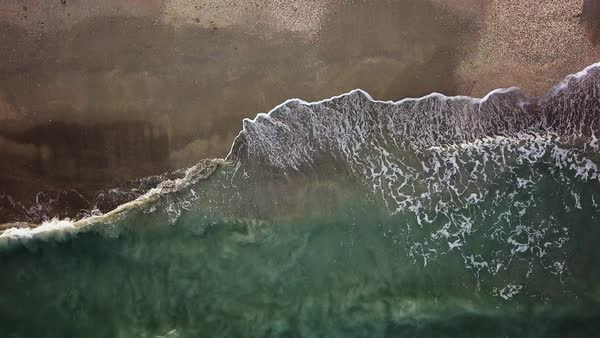 Bird's-eye view of ocean waves  moving towards Jensen Beach Royalty-free stock video