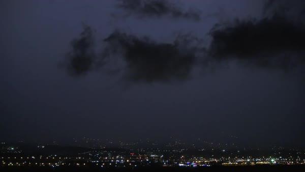 Lightning strikes in dark night sky over the city during a thunderstorm Royalty-free stock video