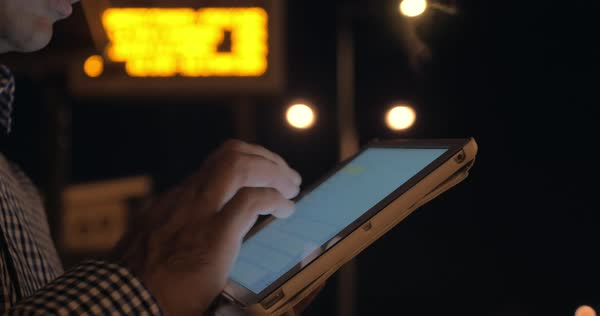 In evening on the street in Thessaloniki, Greece man works on tablet Royalty-free stock video