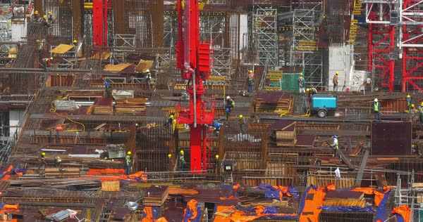 View of construction area and builders working and going between rebar reinforcement Royalty-free stock video