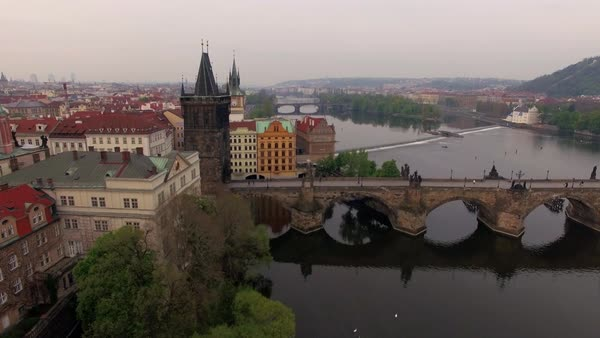 Aerial sunrise view along Charles Bridge across Vltava river in the summer Royalty-free stock video