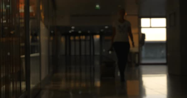 Woman with rolling bag walking at the airport terminal. Going for travel Royalty-free stock video