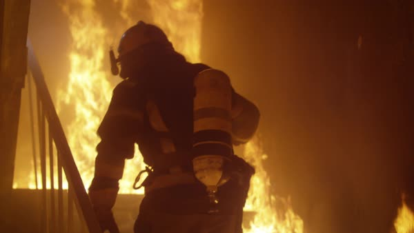 Firefighter runs up the burning stairs Royalty-free stock video
