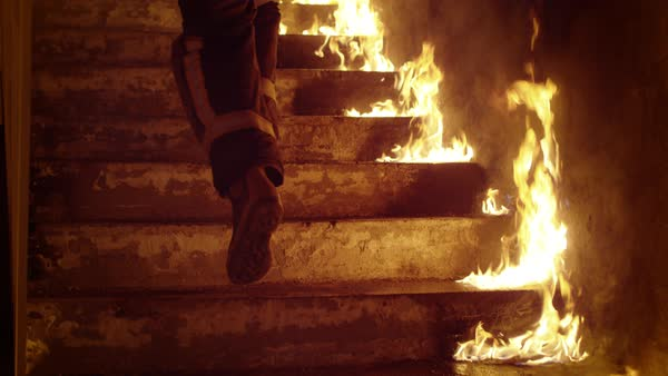 Close-up of a firefighter's legs running up the burning stairs Royalty-free stock video
